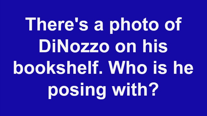 2. There's a photo of DiNozzo on his bookshelf. Who is he posing with?