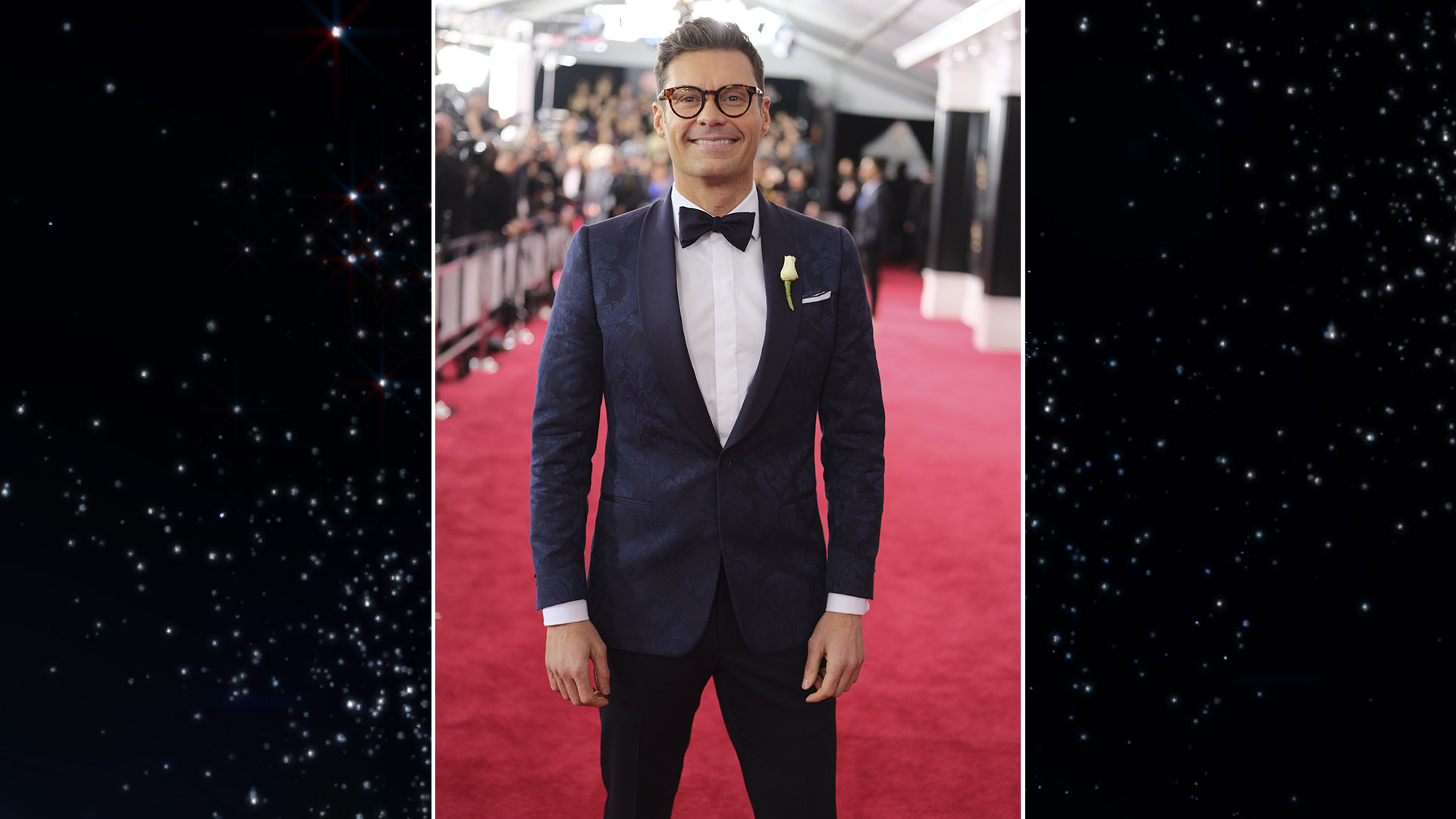 Ryan Seacrest poses proudly in a suit designed by Ryan Seacrest Distinction, the TV personality's own menswear line.