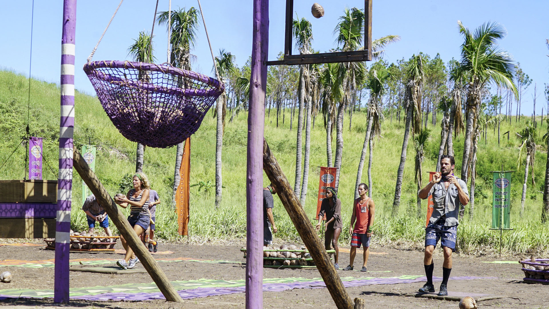 Sunday and Ken try to land their balls into the nets.