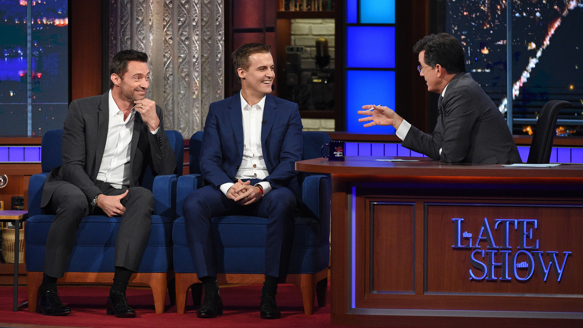 Hugh Jackman, Hugh Evans, and Stephen Colbert