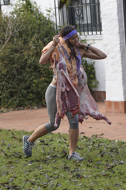 Danielle Littleton (#TheTrackStars) doesn't flinch as she carries meat during the Roadblock.