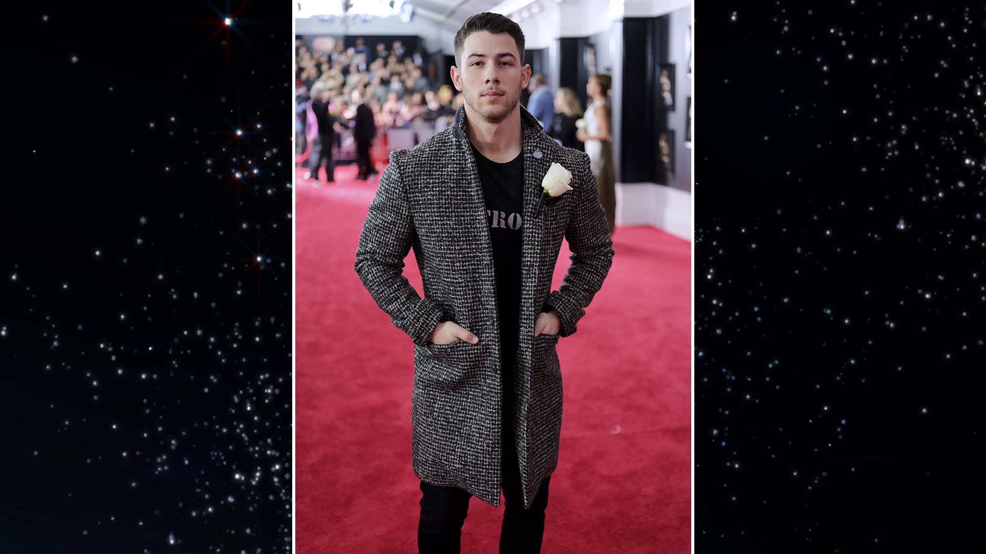 Singer Nick Jonas manages to warm up the red carpet, thanks to a tweed car coat.