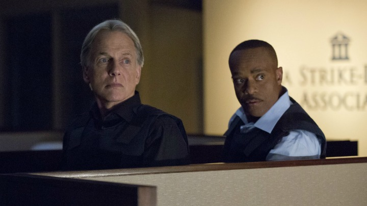 Mark Harmon as Leroy Jethro Gibbs and Rocky Carroll as Leon Vance