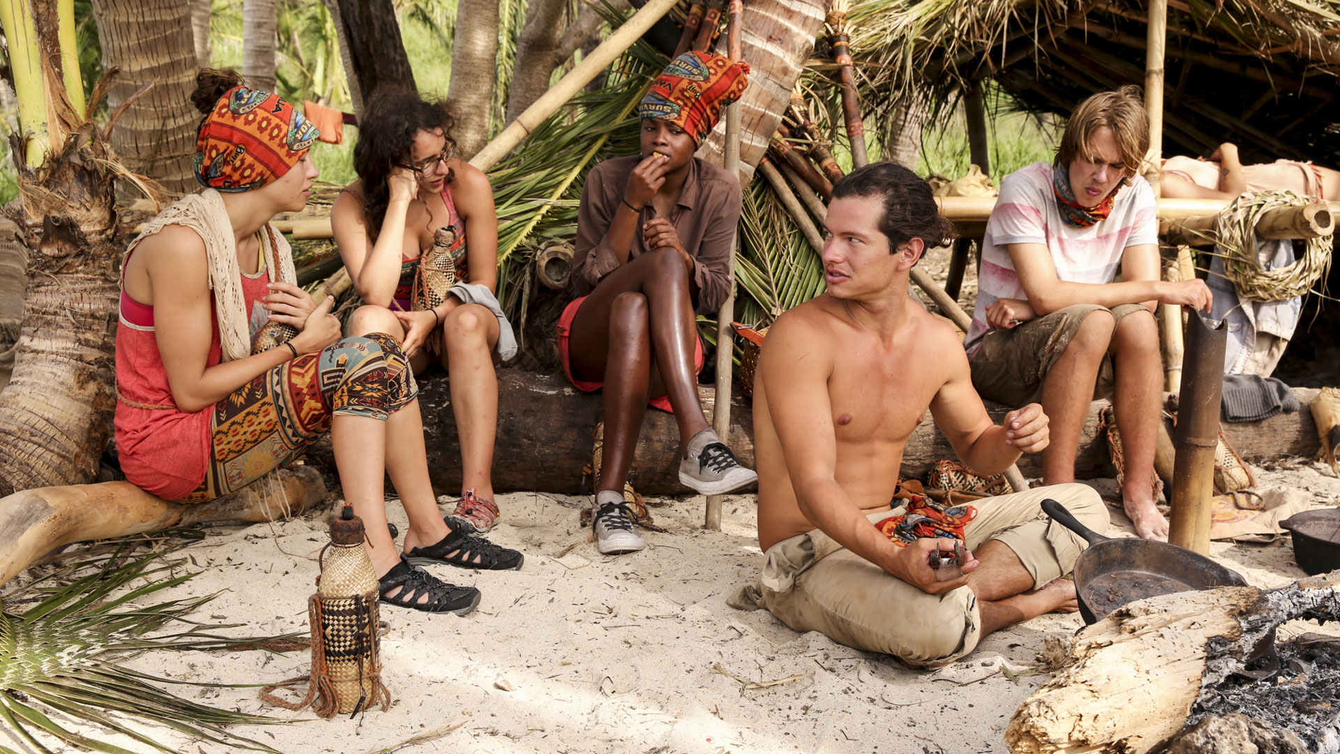 A group of Millennials have a conversation at camp.
