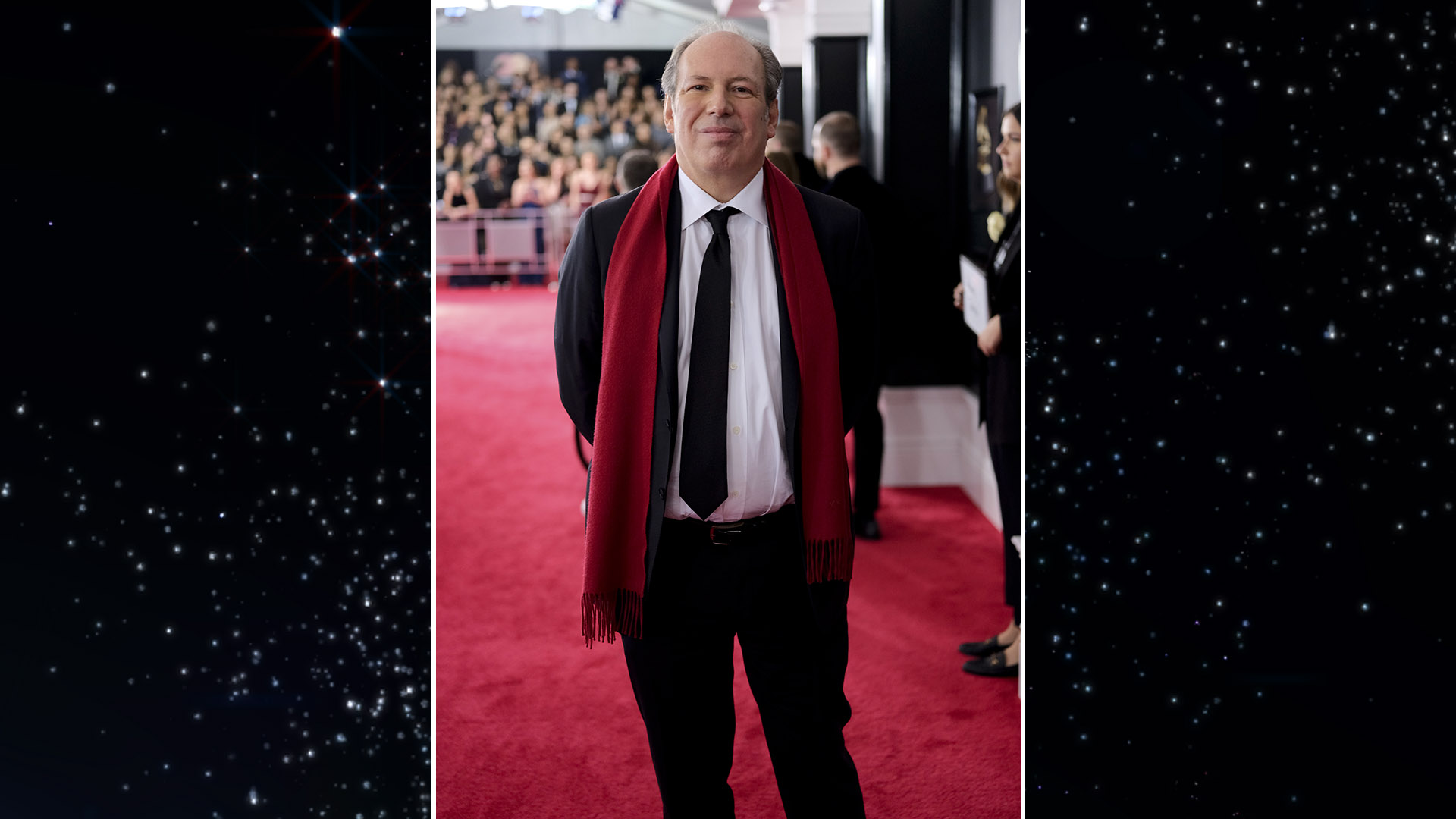 GRAMMY-nominated composer Hans Zimmer stays warm on the red carpet in a crimson wool scarf.