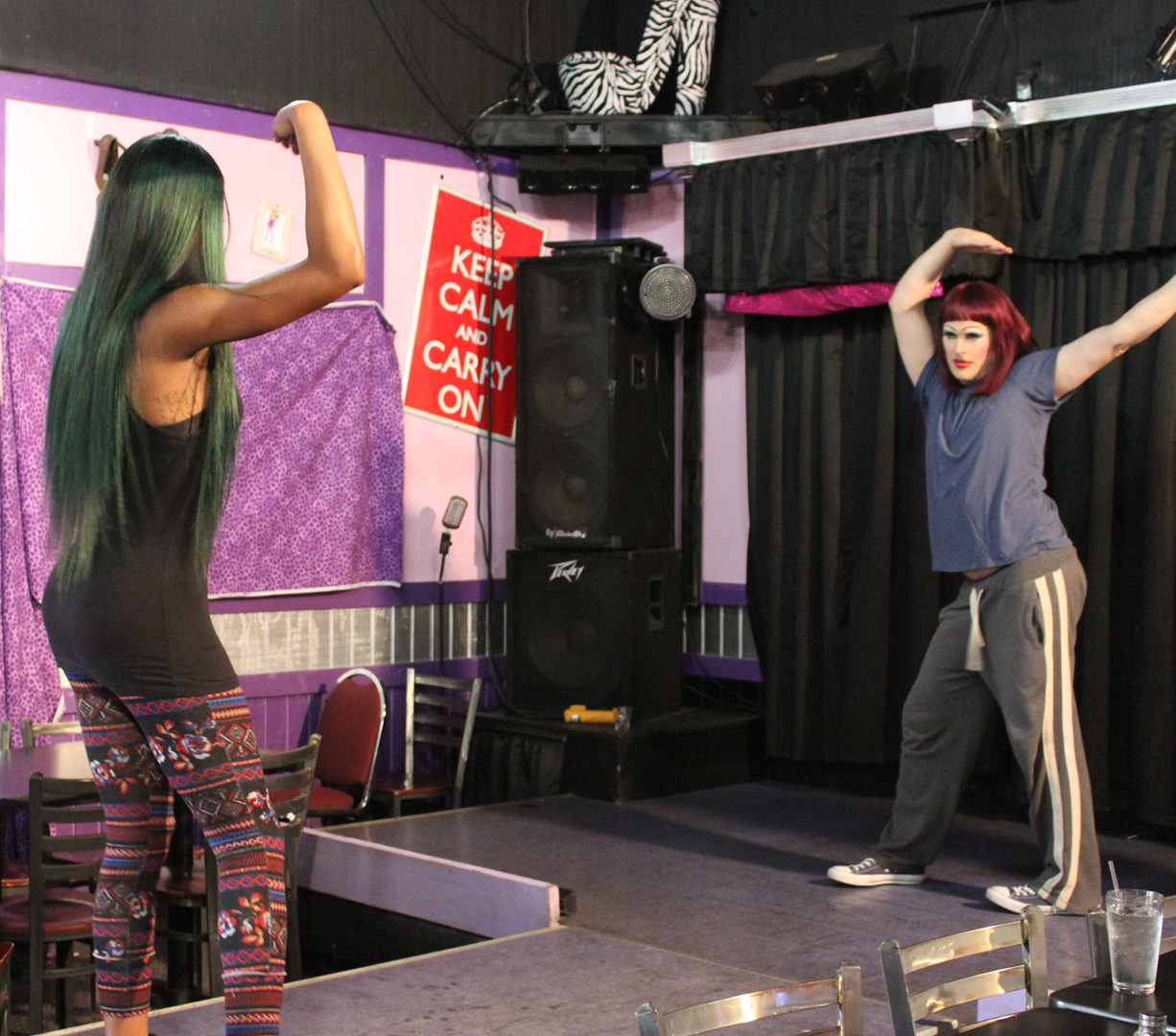 Ashley learns the finer points of performing on stage in drag.