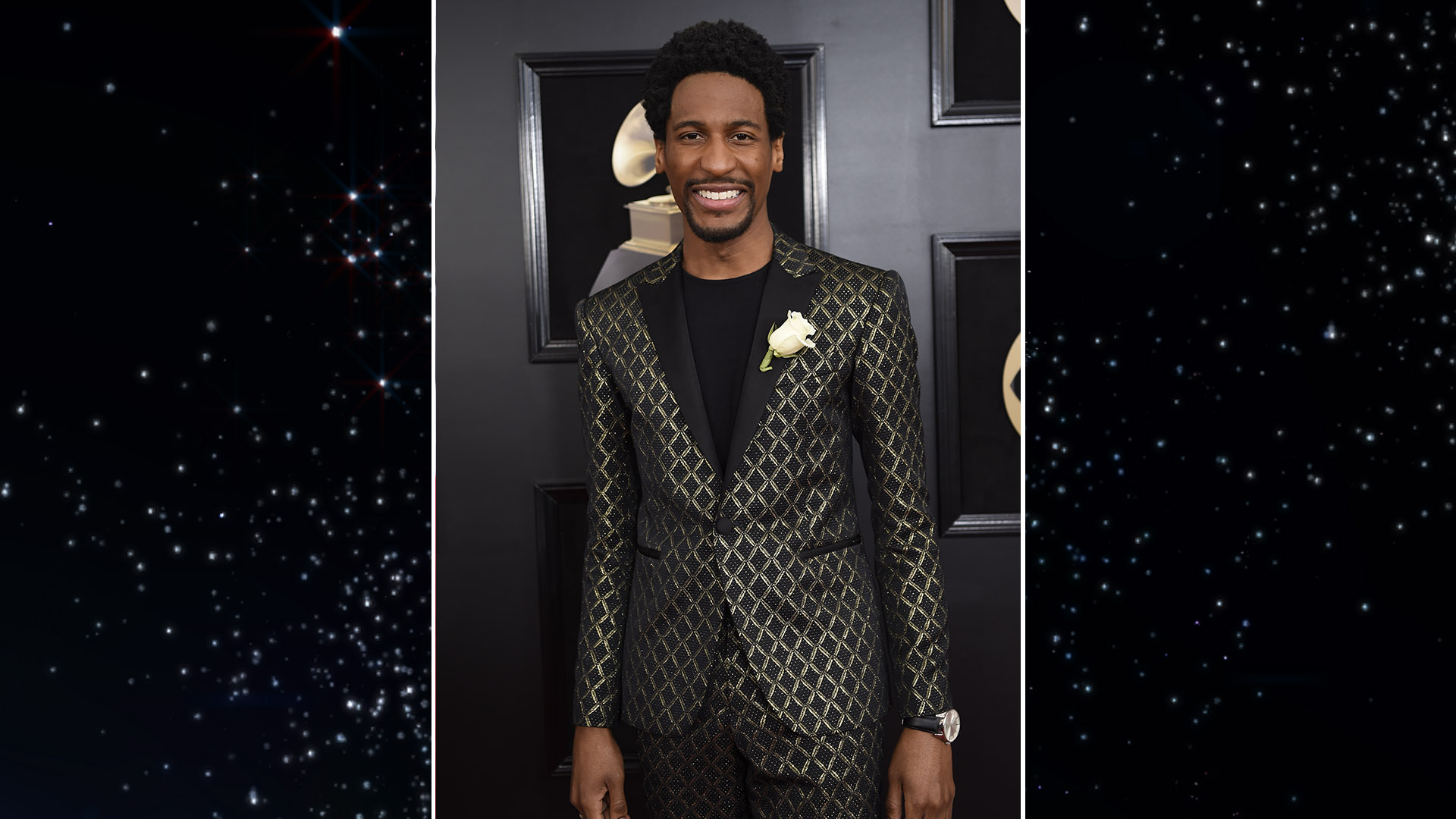The Late Show with Stephen Colbert bandleader Jon Batiste is all smiles before taking the stage to pay tribute to Chuck Berry and Fats Domino.