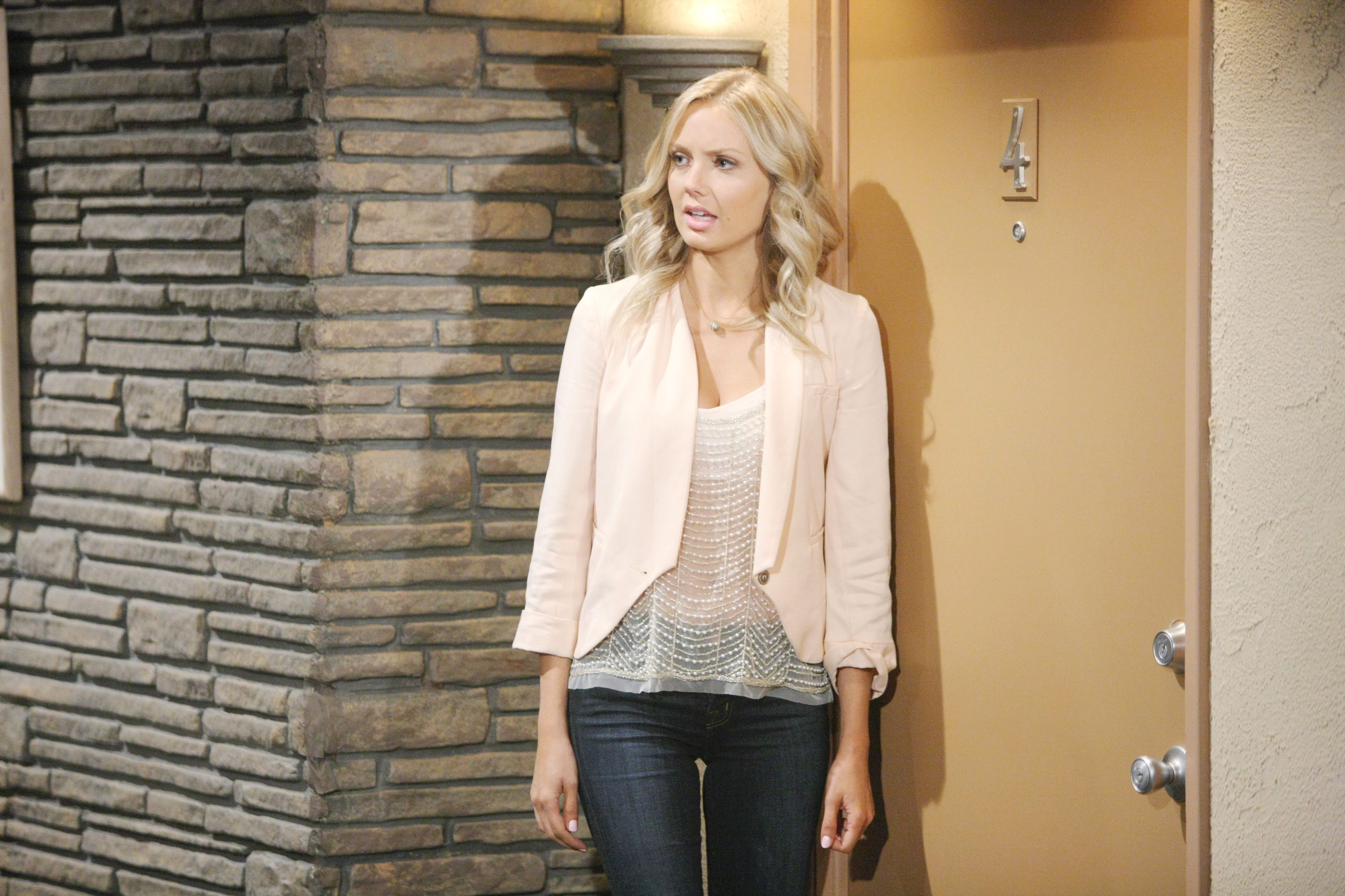 Abby pairs this sheer-pink top and blazer with her baby blues.