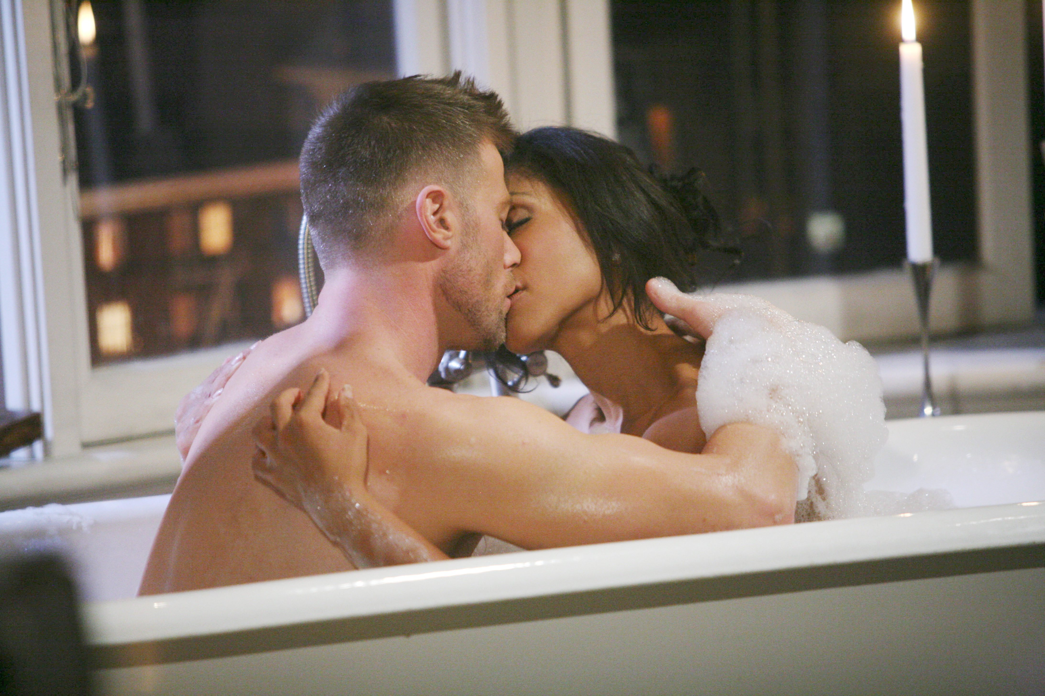 These two are having fun in the tub.