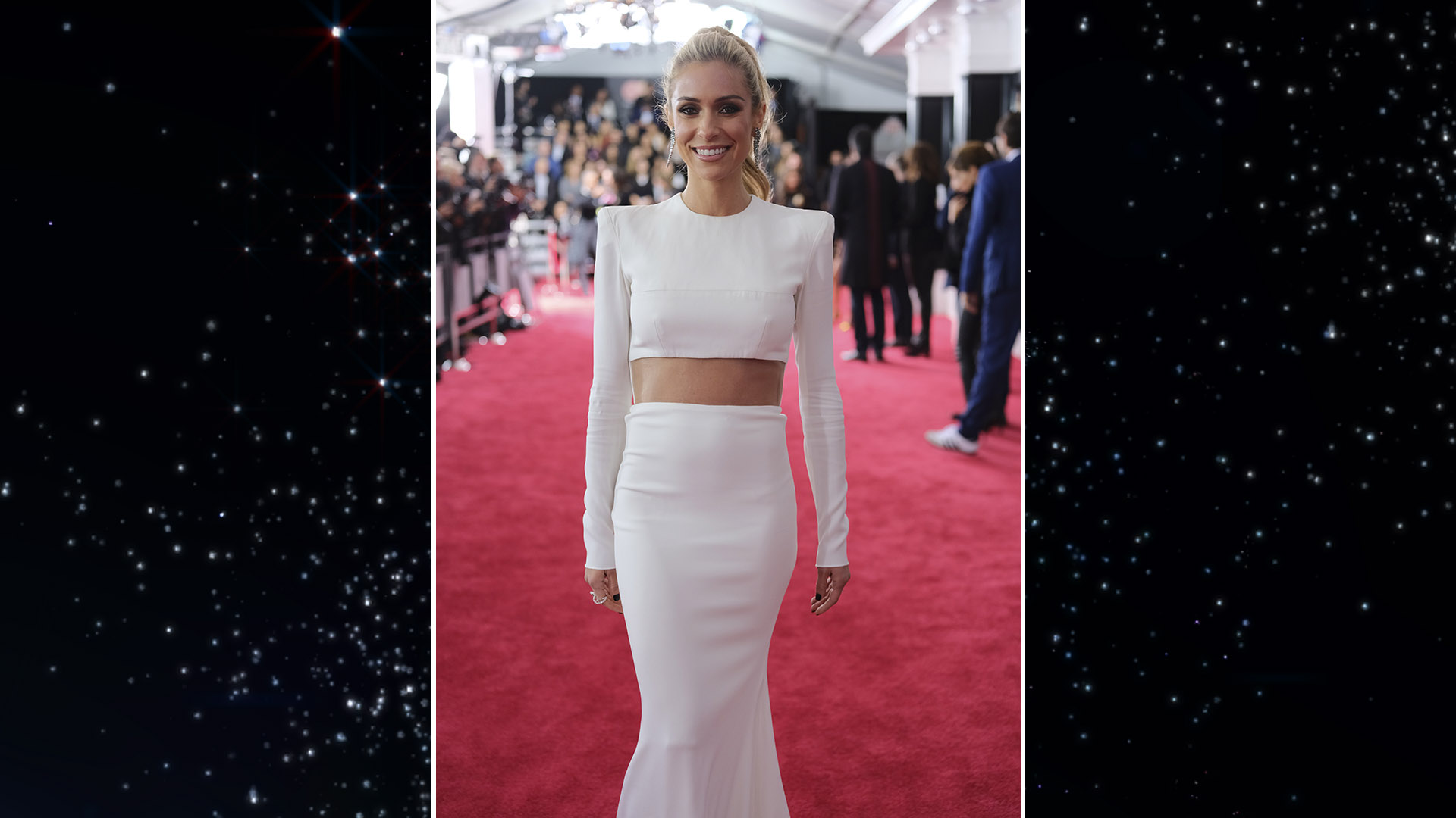 TV personality Kristin Cavallari pairs her two-piece, long-sleeve white gown with a high ponytail.