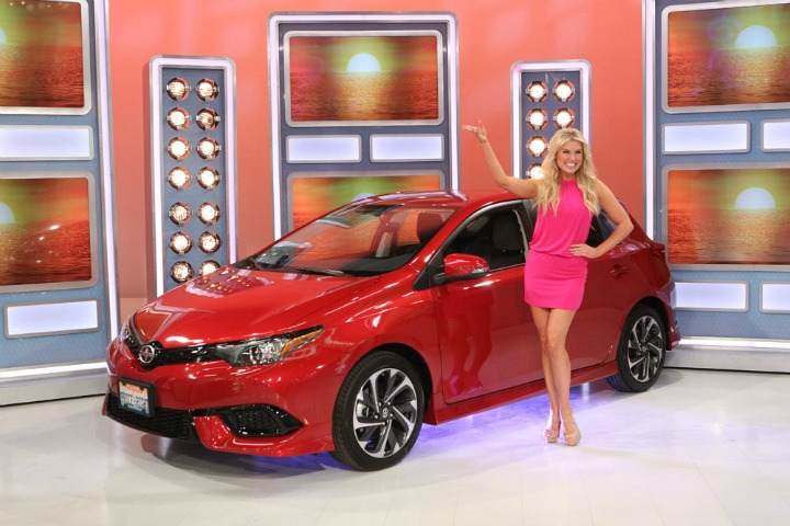 Rachel shows off a shiny new car.