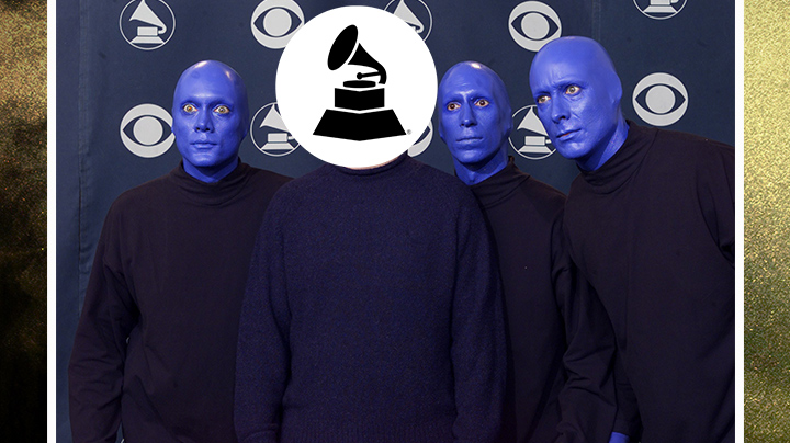 Who wore a mock turtleneck and posed with the Blue Man Group?