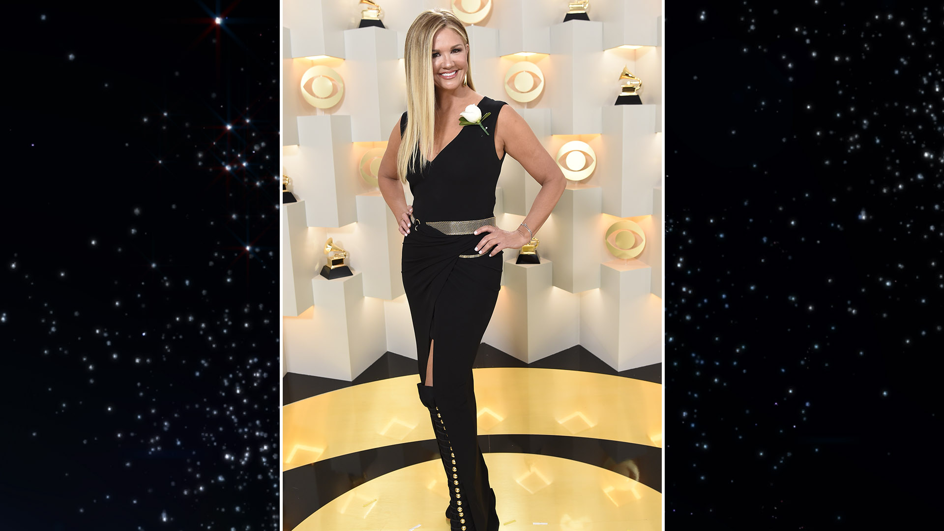 Entertainment Tonight host Nancy O'Dell wears a black slit dress with gold embellishments that match the night's coveted trophy.