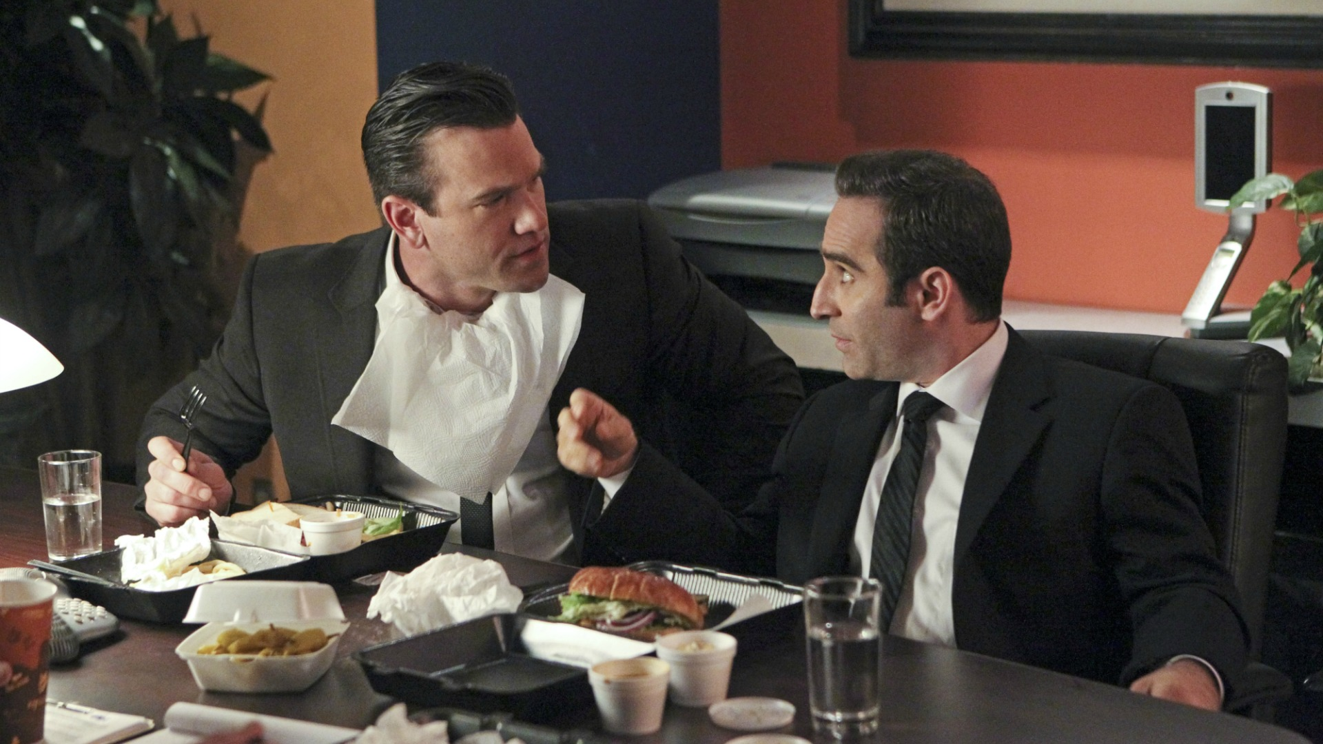 Two suspects share a meal.