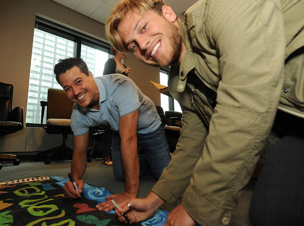Rob and Matt Sign the Murlonio Flag Before Finale