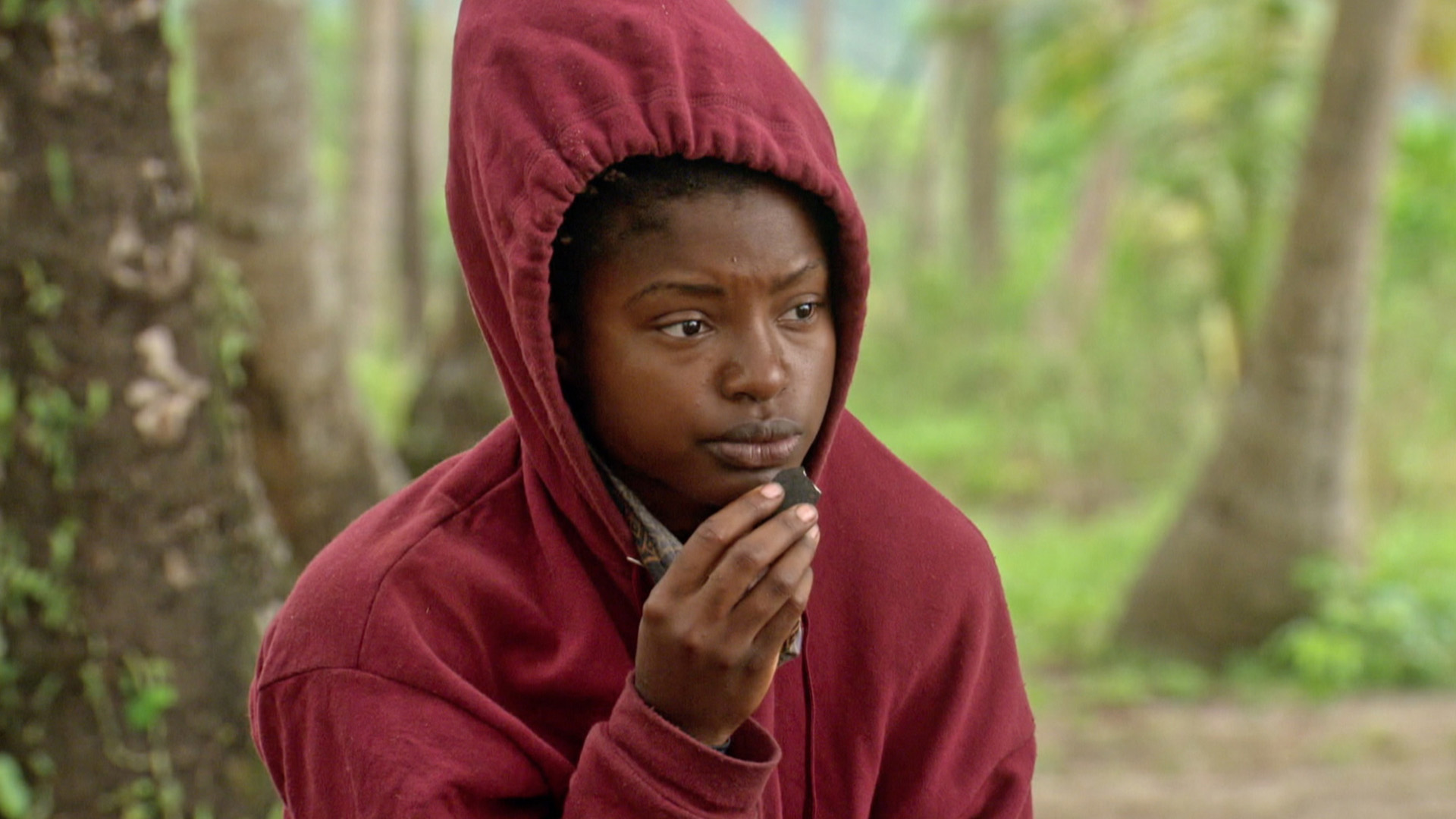 Cydney puts on a hoodie and takes a moment to herself at camp.