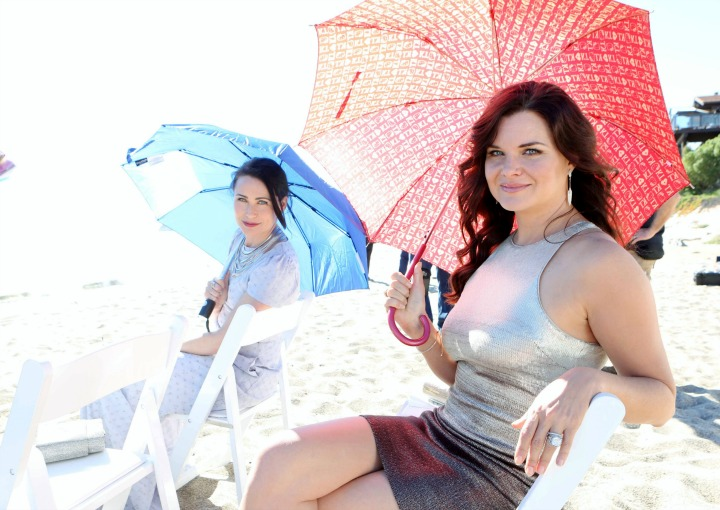 Katie and Quinn relax with their toes in the sand.