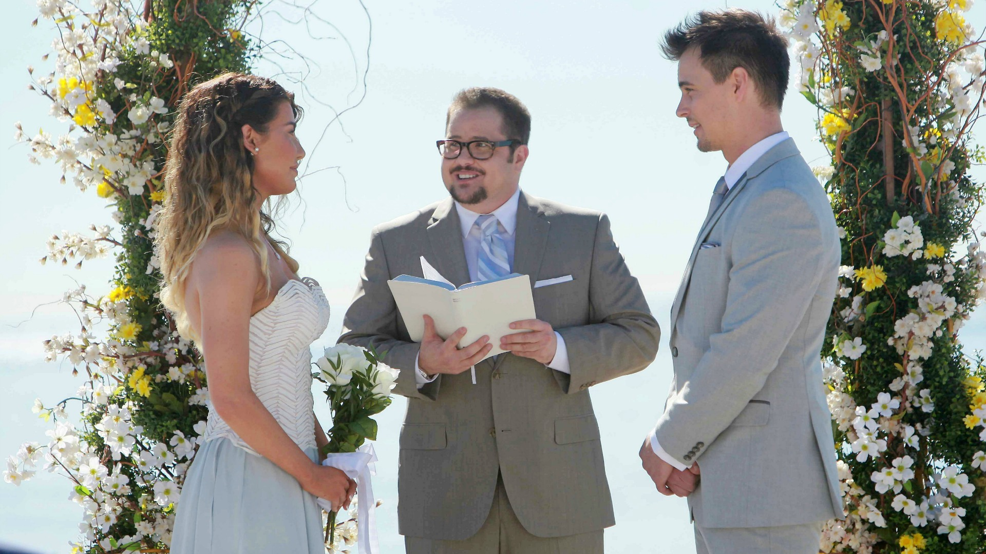 Wyatt lovingly looks at his bride.