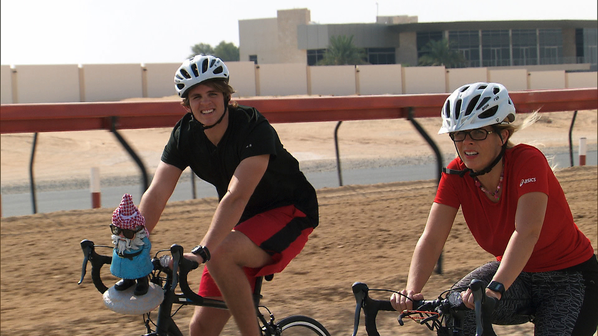 Cole and Sheri pedal as fast as they can at the Al Marmot Camel Track.