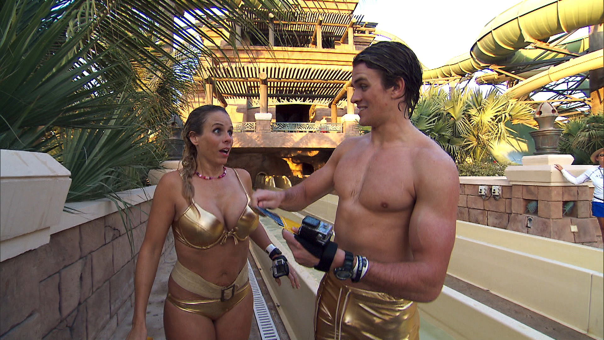 Sheri and Cole put on their golden swimsuits for the next Route Marker.