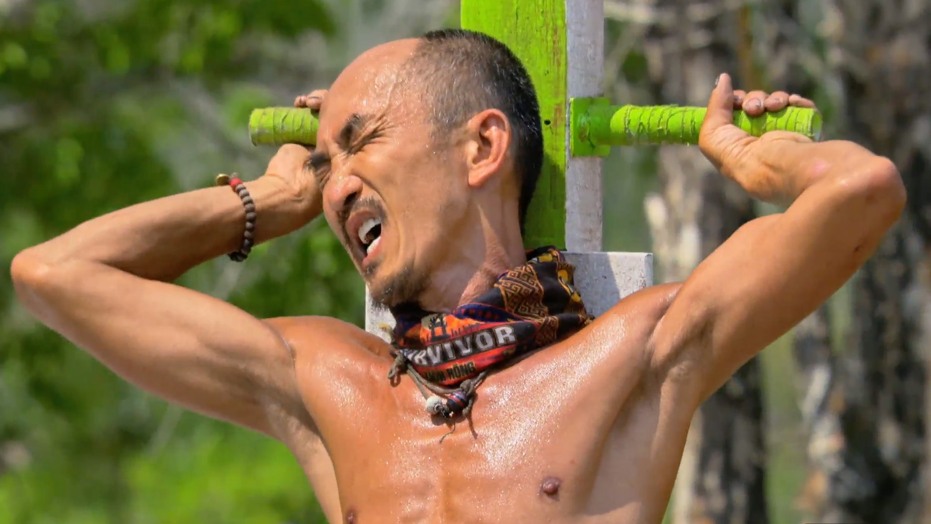 Episode 8: Tai's cringes during the crucifixion challenge.