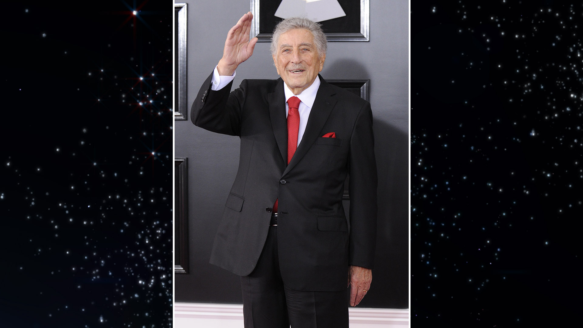 Jazz legend Tony Bennett waves to his many admirers on the 60th Annual GRAMMY Award red carpet.