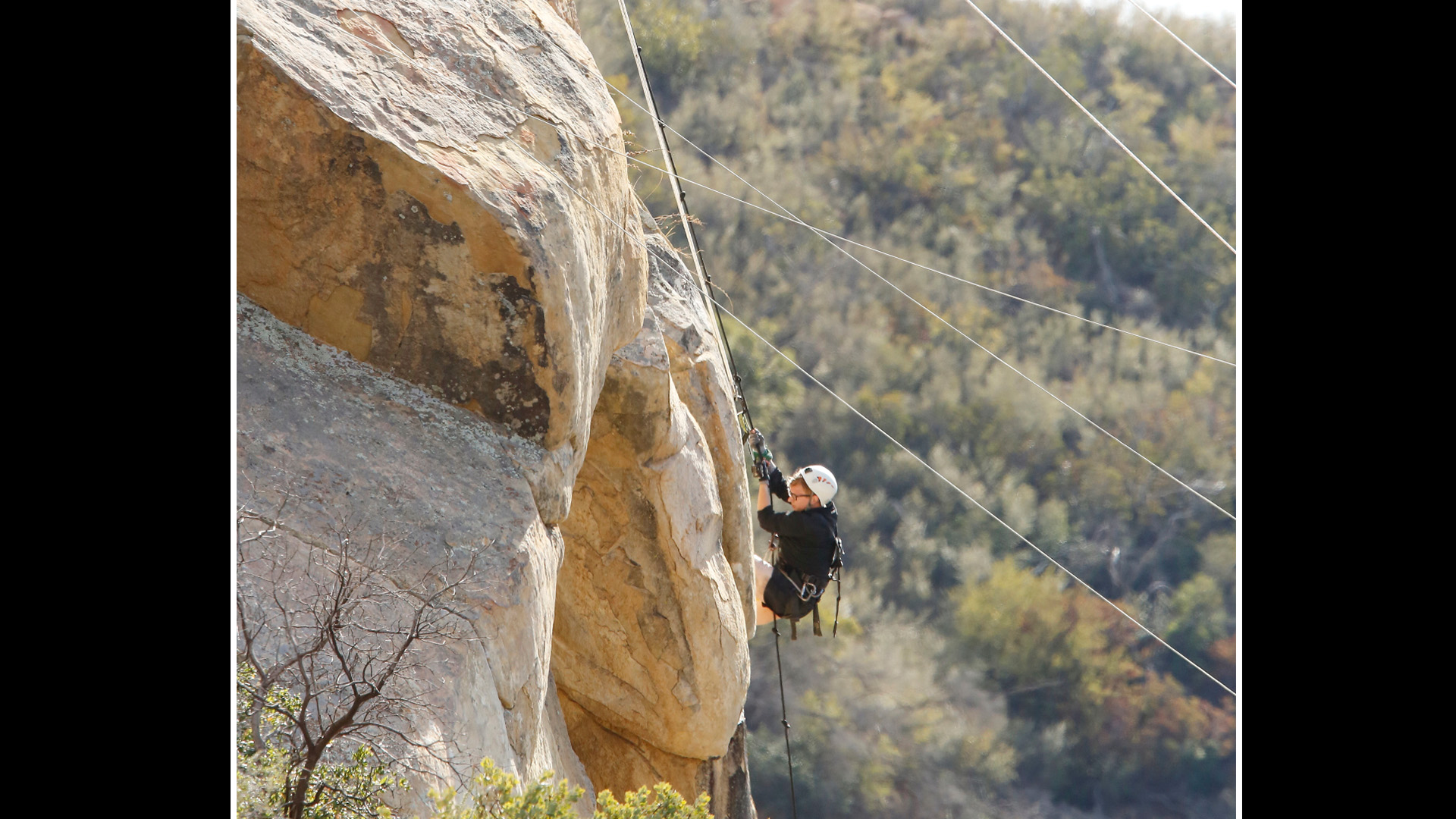 Tyler tries climbing the side of a mountain to retrieve his half of the next clue.