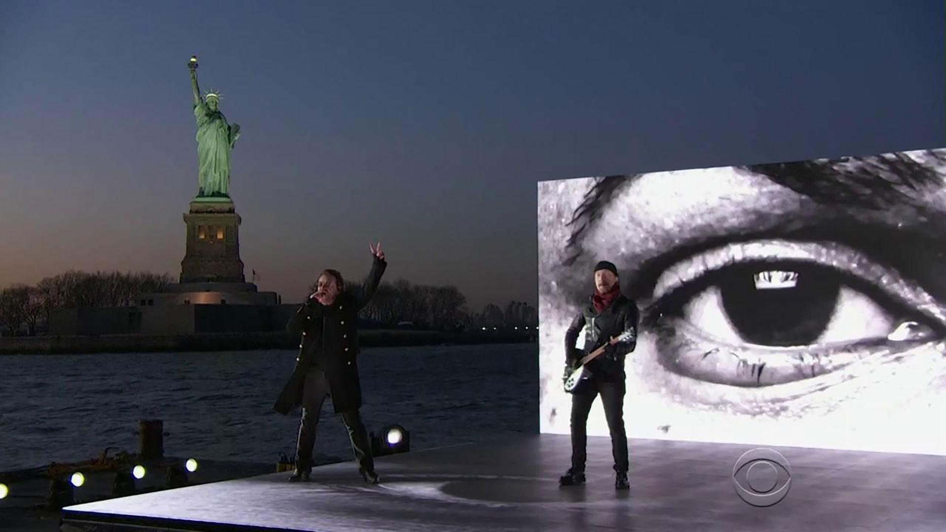 U2 perform their song