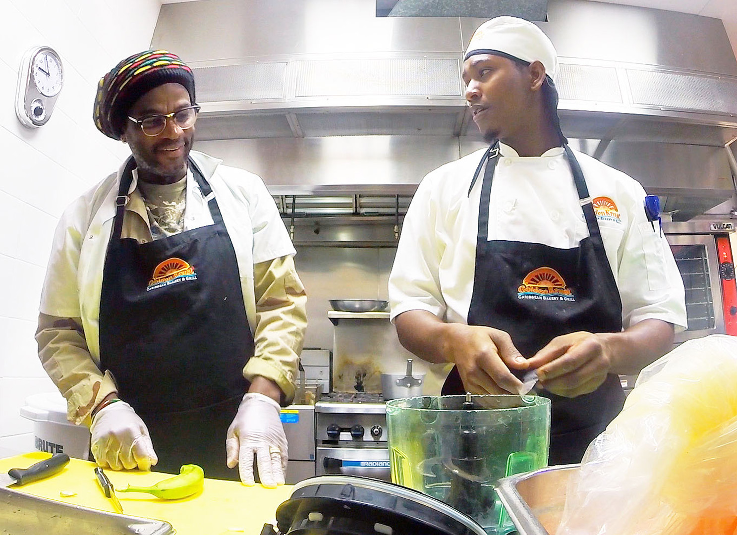 Lowell gets to know Odean, a cook at one of Golden Krust's newest Florida locations.