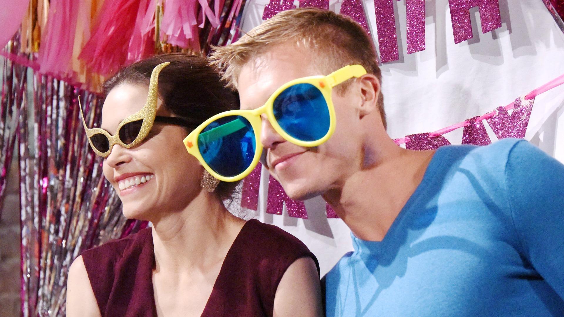 Victoria (Amelia Heinle) and Travis (Michael Roark) goofed around in wacky sunglasses.